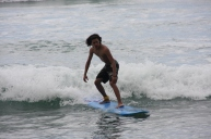 Surfing White Plains Beach, Barbers Point , Oahu