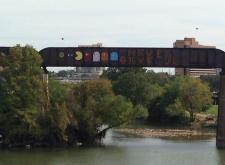 """Never Give Up"" graffiti mural on the Austin Railroad Graffiti Bridge over Lady Bird Lake"
